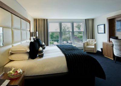 hotelCclessio_Bedroom_Premium_King_1920x1080